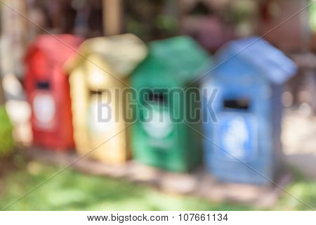 Blurred Photo Of Different Color Bins For Collection The Recycle Materials.