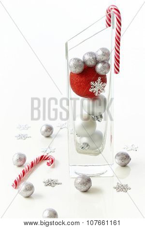 Christmas decoration with candy cane and ornaments.