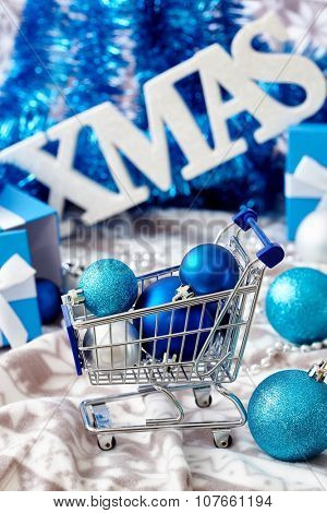 Christmas decoration with blue ornaments and letters xmas.  .