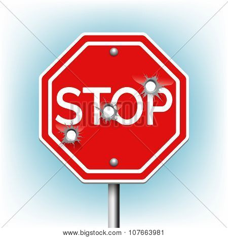 Stop sign with bullet holes