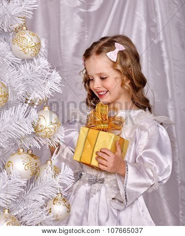Child holding gift box  decorate  Christmas tree. Isolated.