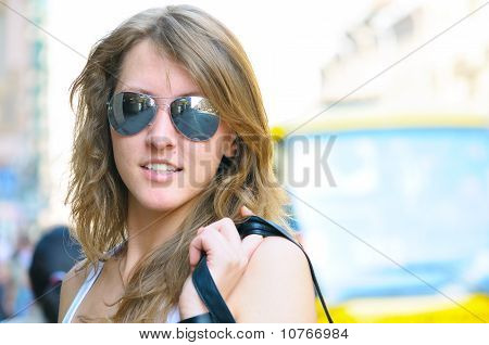 Young Smiling Woman On Bright City Street
