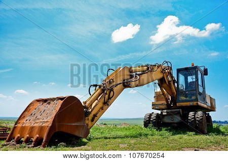 Heavy Earth Mover And Blue Sky, Excavator Machine