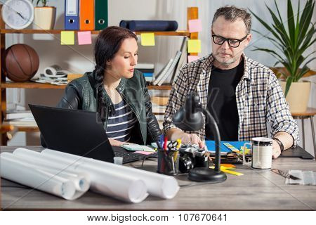 Two hipster managers working on laptop. Small Business Owner. Selective focus