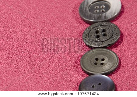 Dark Buttons On Red Cloth With Space For Inscription