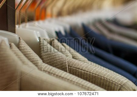 Stylish Jackets Hanging On The Rack In The Store