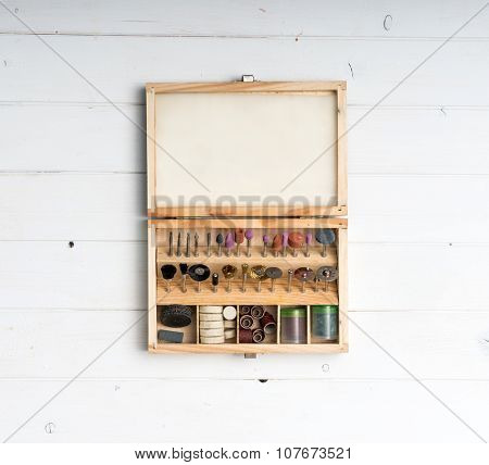 wooden box with different nozzles for grinder on wooden table