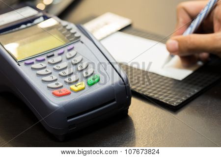 Color Buttons On Credit Card Machine With Signing Transaction In Background : Selective Focus