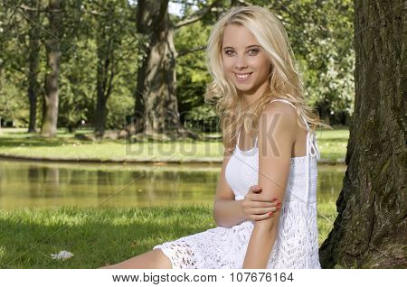 Portrait of a beautiful young adult attractive pretty blond sensuality woman in the garden