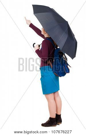 pointing  woman with a backpack  under an umbrella. Rear view people collection.  backside view of person.  Isolated over white background.