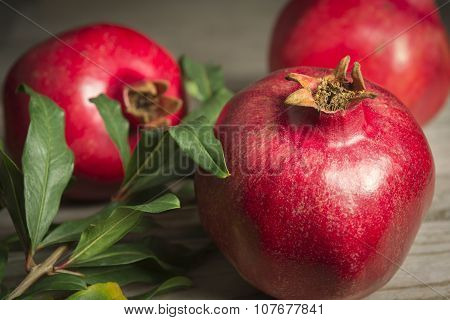 Pomegranate fruits on a wooden table