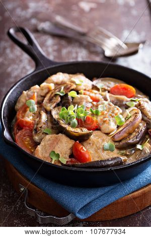 Chicken with tomatoes and eggplant