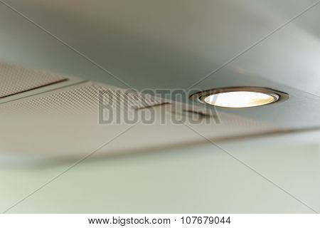 closeup of a modern inox cooker hood, light