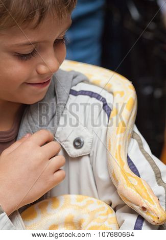 Boy With The Python