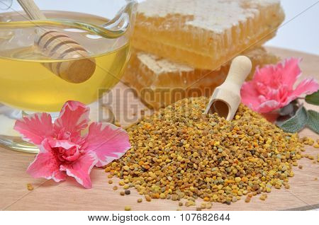 Savory Pollen, Honey, Honeycombs And Flowers