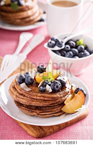 Cinnamon coconut flour pancakes with fresh fruits