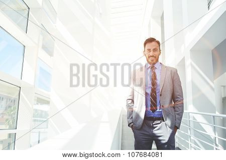 Young happy intelligent lawyer posing with copy space area for text