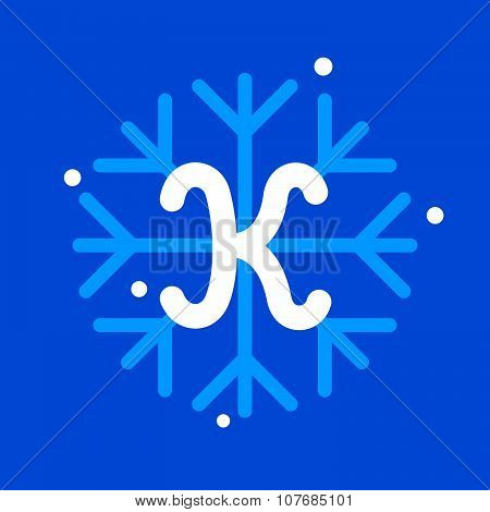 K Letter With Snowflake Icon On The Blue Background.
