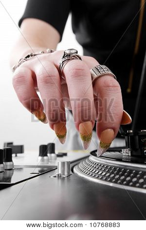 Hands Of Female Dj Puting Needle On Record