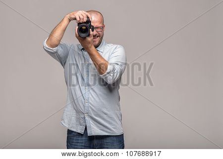 Male Photographer Focusing An Image