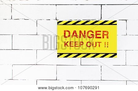 Cement Block Wall With Danger Keep Out Sign