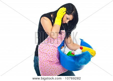 Tired Housewife Carrying Cleaning Products