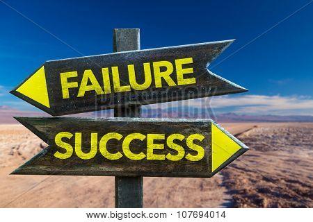 Failure Success signpost in a desert background