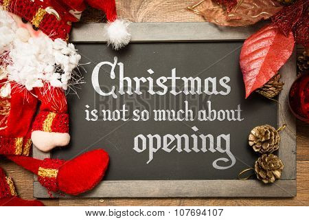 Blackboard with the text: Christmas Is Not So Much About Opening in a conceptual image