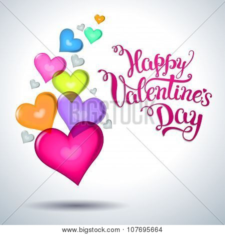 Several Multicolored Hearts And Original Hand Lettering  Happy Valentine's Day.