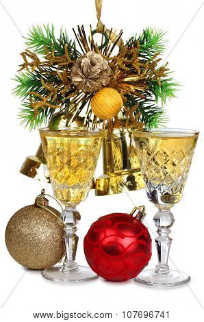 Christmas toys and wineglasses on white background