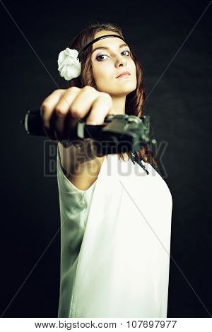 Lady In White With Gun