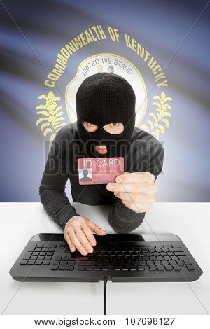 Hacker With Usa States Flag On Background And Id Card In Hand - Kentucky