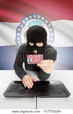 Hacker With Usa States Flag On Background And Id Card In Hand - Missouri
