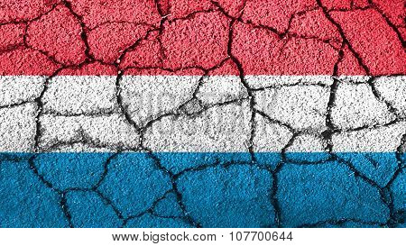 Flag of Luxembourg painted on cracked ground