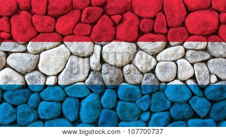 Flag of Luxembourg painted on stone