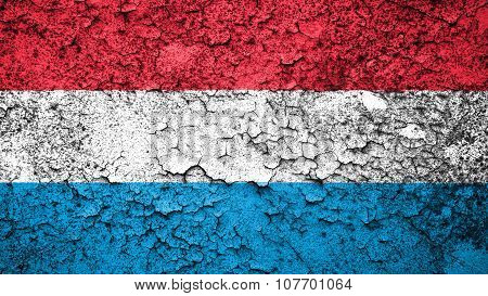 Flag of Luxembourg painted on cracked paint