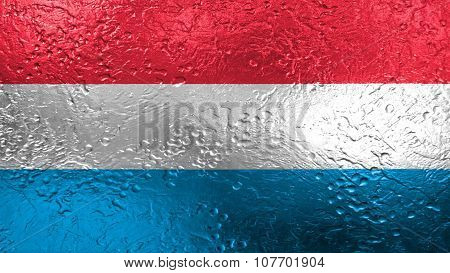 Flag of Luxembourg painted on metal texture
