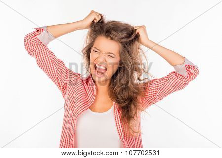 Portrait Of Crazy Funny Girl Shouting And Holding Hair