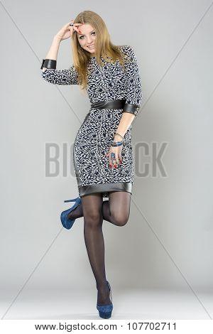 beautiful woman with long  legs dressed elegant posing in the studio - full body