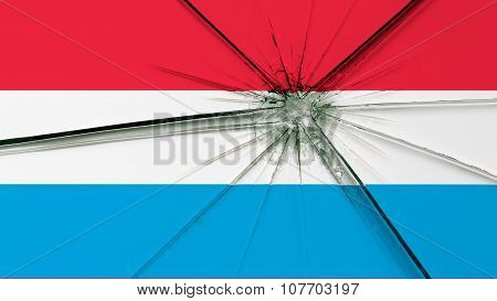 Flag of Luxembourg painted on broken glass