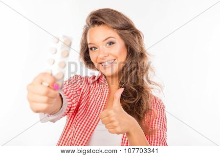 Attractive Girl Holding Tablets And Gesturing Thumb Up