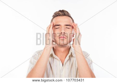 Handsome Young Man Touching His Head Suffering From Headache