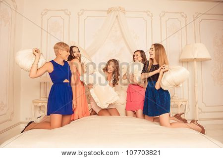 Happy Girls Celebrating A Bachelorette Party And Playing With Pillows