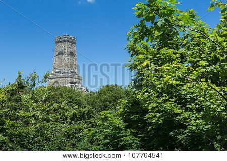 Memorial Shipka in Bulgaria on the background of green foliage