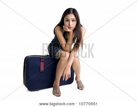 Pretty Woman Sitting On A Bag