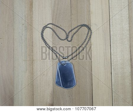 Military Dog Tags On Wood Background , Vetarans Day Concept