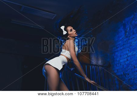 Sensual Girl Standing At The Handrailing Throwing Her Hair