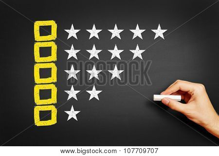 Hand draws concept for feedback with checkboxes and stars on blackboard