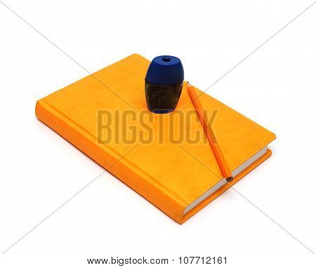 Orange Notebook, Pencil And Sharpener