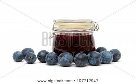 Plums And Plum Jam In The Bank On A White Background